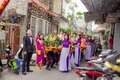 Procession on streets with confetti couples in colorful outfits in of asia in air sunny day Stock Images