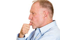 Procrastination closeup side view profile portrait senior mature man with finger in mouth sucking thumb biting fingernail deep in Royalty Free Stock Images