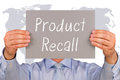 Product Recall - Manager with sign and text Royalty Free Stock Photo