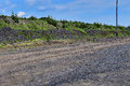 Production area with road and rocks Royalty Free Stock Photo