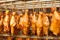 Production of smoked chicken legs. Royalty Free Stock Photo