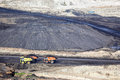 Production useful minerals the dump truck at mining coal Stock Photos