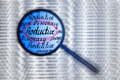 Productive concept magnifying glass look for blue toning hand writing Royalty Free Stock Photography