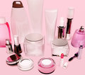 Products of care of skin, hair, decorative cosmetics on pink bac