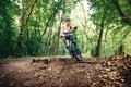 Professioanl biker, extreme sports, cyclist on bike on mountain trail Royalty Free Stock Photo