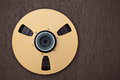 Professional audio metal reel on brown background Royalty Free Stock Images
