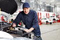 Professional auto mechanic car working in repair service Stock Photos
