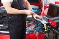 Professional auto mechanic working in repair service Stock Images