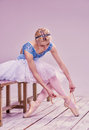 Professional ballerina putting on her ballet shoes Royalty Free Stock Photo