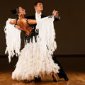 Professional ballroom dance couple preform an exhibition dance romantic Stock Photography
