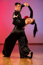 Professional ballroom dance couple preform an exhibition dance romantic Stock Images