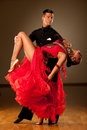Professional ballroom dance couple preform an exhibition dance romantic Royalty Free Stock Photography