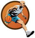 Professional basketball player dribbling in jump w with a ball and jumping out of orange oval frame Stock Images