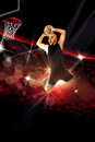 Professional basketball player makes a slam dunk in the game Royalty Free Stock Photo