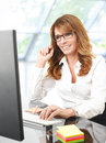 Professional businesswoman working on laptop in her office Royalty Free Stock Photos