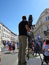 Professional Cameraman Filming and Broadcasting on Platform in City Royalty Free Stock Photo