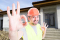 Professional construction services concept with cheerful builder Royalty Free Stock Photo