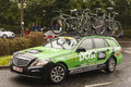 Professional cycling support vehicle an an post chain reaction on stage of the tour of britain bicycle race in canonbie scotland Royalty Free Stock Photo