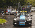 Professional cycling support vehicle a team sky on stage of the tour of britain bicycle race in canonbie scotland Royalty Free Stock Photography