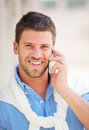 Professional entrepreneur talking on cell phone young confident happy and successful Royalty Free Stock Image