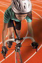 Professional female athlete riding bike on a track vertical sho portrait of woman race model equipped with biking gear uses race Stock Photography