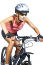 Professional female cycling athlete riding mountain bike wearing clothes isolated over white background vertical shot Royalty Free Stock Photos