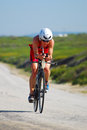 Professional female ironman triathlete cycling front view of and winner jessie donavan usa in the specsavers triathlon event in Stock Photography
