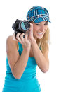 Professional female stock photographer isolated on white holding her camera in hands Stock Images