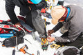 stock image of  A professional guide helps you set up and dress alpinist crampons
