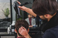 Professional hairdresser making human head dry Royalty Free Stock Photo