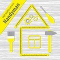 Professional Handyman Services. Silhouette of a house from a yellow building ruler. Set of repair tools on white wooden background Royalty Free Stock Photo