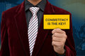 Professional holding card of Consistency is the Royalty Free Stock Photo