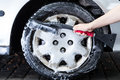Professional hubcap cleaning horizontal view of a Royalty Free Stock Image