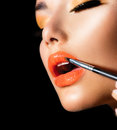 Professional make up applying lipgloss lipstick Stock Images