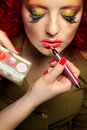 Professional make up artist doing glamour model makeup at work Royalty Free Stock Images