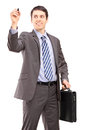 Professional man briefcase writing something imaginary isolated white background Royalty Free Stock Photos