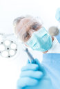 Professional mature dentist in medical mask