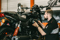 Professional mechanic change the air filter in the motorcycle. Royalty Free Stock Photo