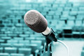 Professional microphone against concert hall Royalty Free Stock Photos