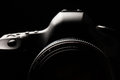 Professional modern dslr camera low key image with a very wide aperture lens on Stock Images