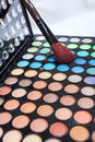 Professional multi colored eyeshadow makeup with a brush inside Stock Photos