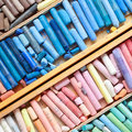 Professional multicolored pastel crayons in wooden artist box Royalty Free Stock Photo