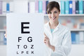 Professional oculist holding an eye chart Royalty Free Stock Photo