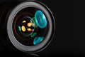 Professional photo lens in dark background with colorful reflections Royalty Free Stock Image