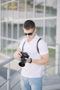 Professional photographer with camera outdoors. Royalty Free Stock Photo