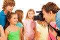 Professional photographer photographing kids adult beautiful boys and girls with dslr camera Stock Images