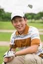 Professional player vertical portrait of a handsome golf with a golf iron posing at camera Stock Images