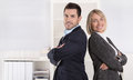 Professional senior and junior business team in portrait in the Royalty Free Stock Photo