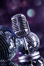 Professional silver microphone on a black glossy background Stock Photo