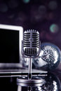 Professional silver microphone on a black glossy background Stock Images